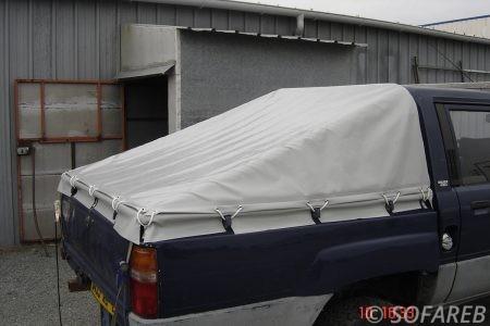 bache-sur-mesure-qualite-professionnelle-industriel-sur-mesure-mesures-vendée-bâche-baches-bâches-qualité-Sofareb-local-expérience-découpe-précision-particulier-professionnel-pickup-voiture-véhicule-protection