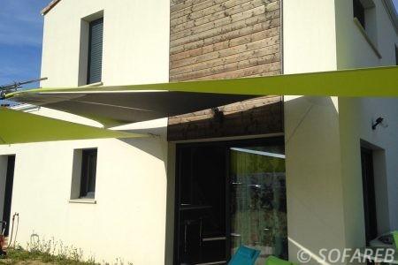 Voile d-ombrage vert et noir devanture maison creation sofareb